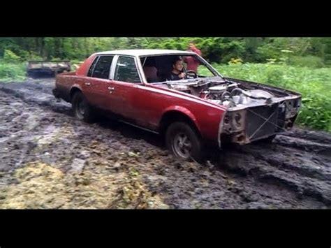 mudding cars blown impala car mudding mud bog