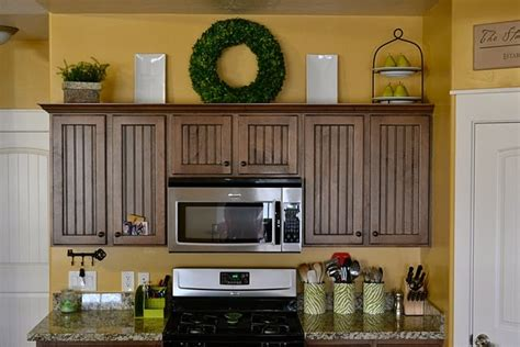 greenery above kitchen cabinets wreath on top of cabinets interesting way to add some
