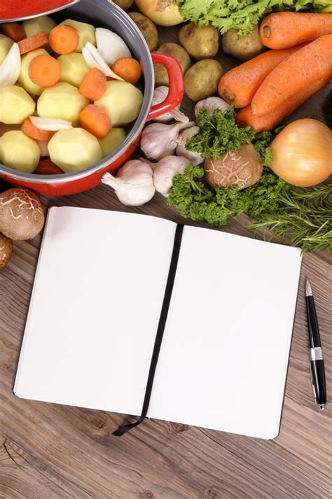 Notebook Wooden Table wooden table with food and notebook photo free