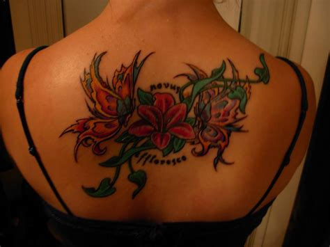 flower with butterfly tattoo designs feminine flower tattoos for