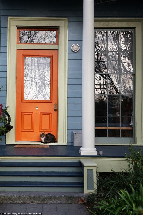 blue house orange door couple buy 1840s creole cottage and move it brick by brick