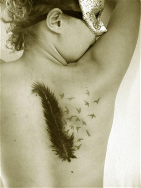 Feather Tattoo Upper Back | crow feather birds tattoo on upper back tattooshunt com