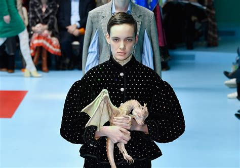 gucci debuts baby dragons game  thrones style  runway