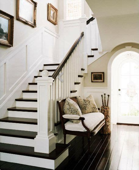 bench under stairs foyer with dark wood louis xvi bench with white cushions