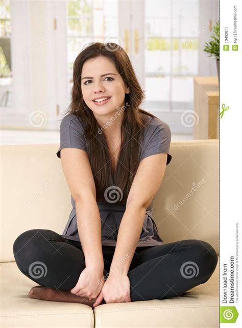 girl on the couch girl sitting on couch royalty free stock photography