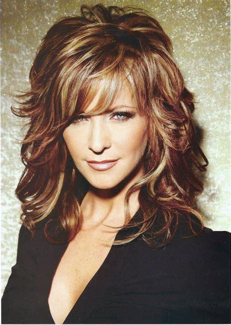 layered hairstyles 50 medium length hairstyles with bangs for women over 50