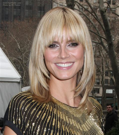 tapered bangs hairstyles heidi klum with her hair cut just over the shoulders