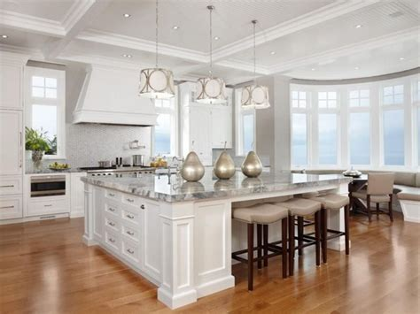large white traditional kitchen island with superb stools
