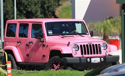 pink jeep amber rose in her pink jeep driving around in los angeles