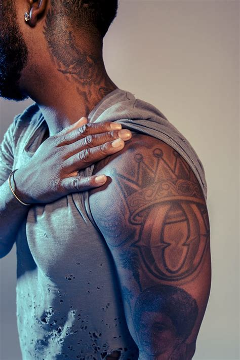 omarion tattoos r b artist omarion gives an insight on his tattoos tattoodo