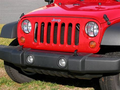rugged ridge headlight guards rugged ridge 11230 03 rugged ridge front light guards in black for 07 16 jeep 174 wrangler