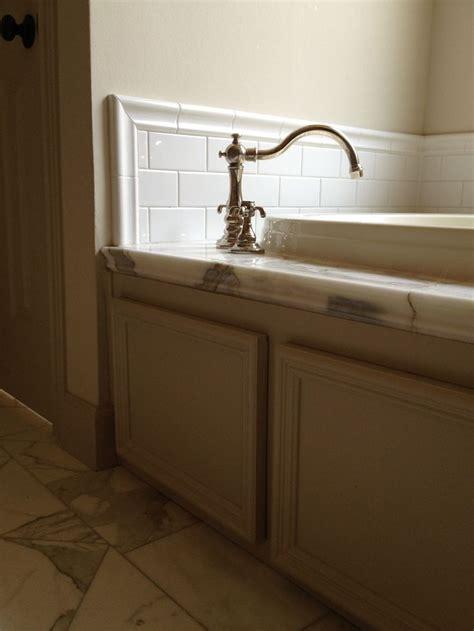 tile front of bathtub calacutta marble floor and tub deck restoration hardware