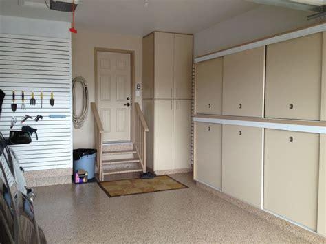 garage storage cabinets with sliding doors gerry garage slotwall epoxy floor custom cabinets