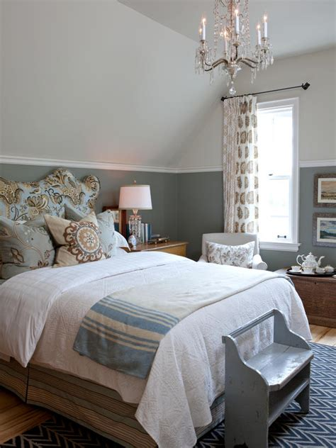 beautiful bright quilts white bead board walls and baskets tucked under the bed give this