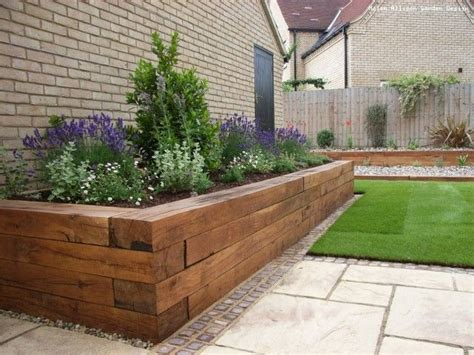raised flower bed like the way the tiles and grass are