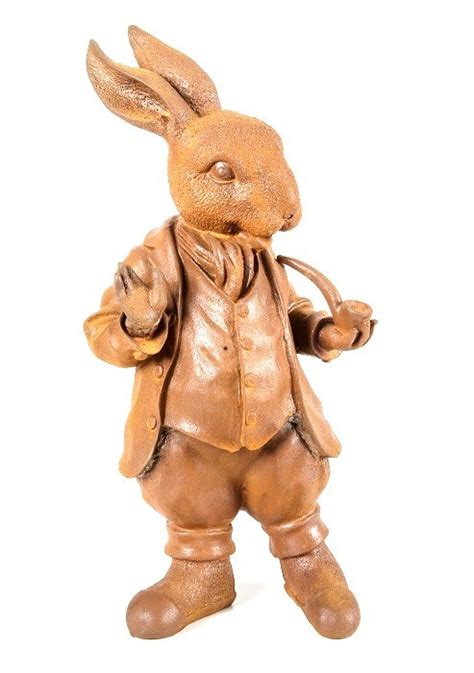rusted cast iron mad hatter rabbit garden ornament
