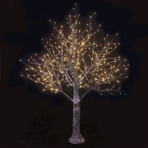 and white outdoor lights brown snowy twig tree warm white led lights