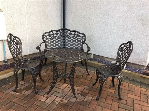 cast iron table and chairs garden black cast iron effect table chairs bench in