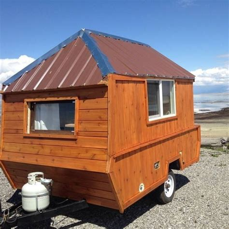pop up tiny house man converts pop up trailer into micro cabin on wheels tiny houses similar spaces