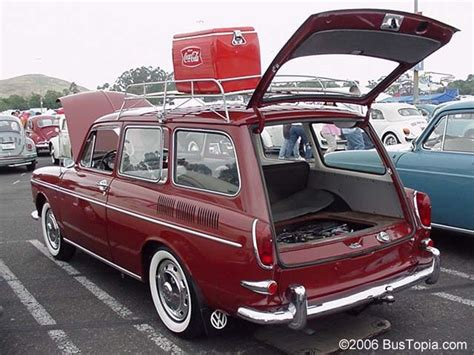 classic volkswagen station wagon volkswagen variant wagon with vintage cooler and roof rack