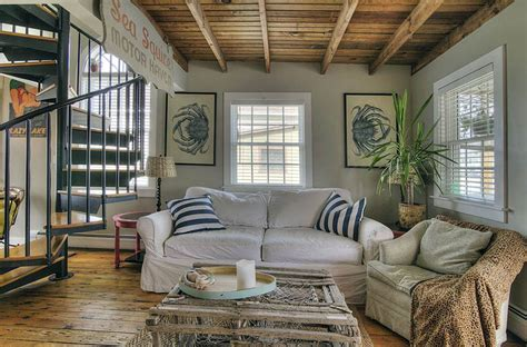 beautiful Ocean Themed Living Room #1: cottage-style-living-room-with-nautical-theme-ocean-art-and-crab-trap-coffee-table.jpg