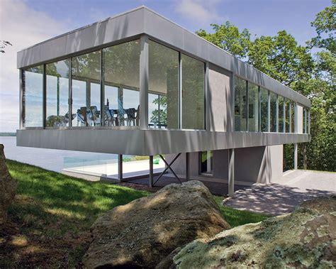 vertical t shaped hilltop house exposes views on all 4