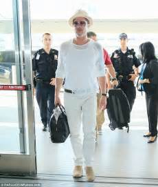 brad pitt 52 looks cool in an all white and