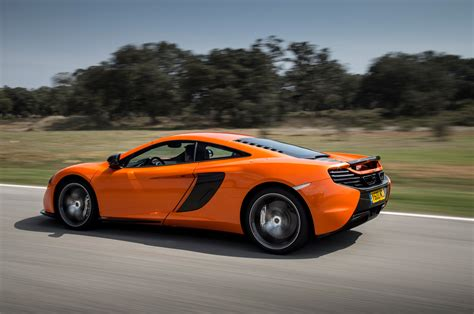2015 mclaren 650s coupe side in motion photo 9