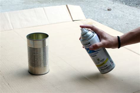 spray paint shake 4th of july craft tin can luminaries welcome to the woods