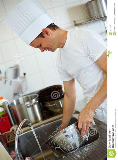 chef washing  royalty  stock photography image