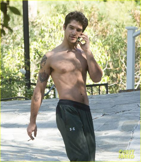 full sized photo of tyler posey goes shirtless as he works