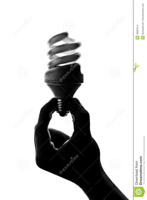 silhouette  hand holding spiral lamp stock photo image