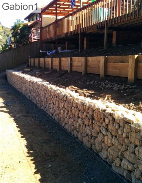 gabion retaining wall 36 quot tall x 18 quot thick using rounded river rocks as fill http www gabion1