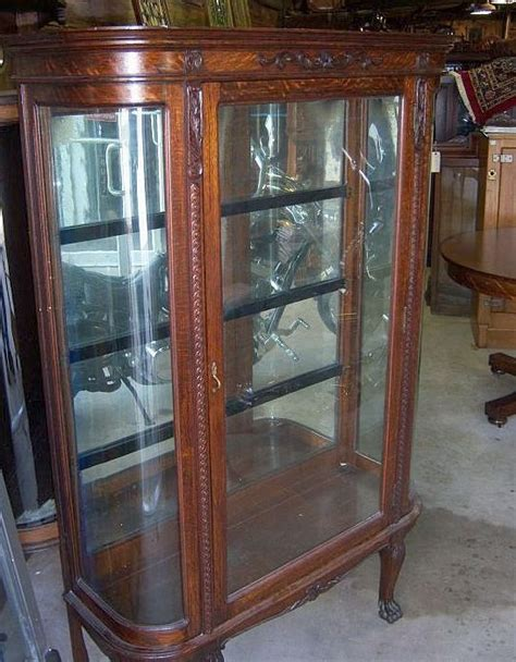 oak curved glass china cabinet carving from