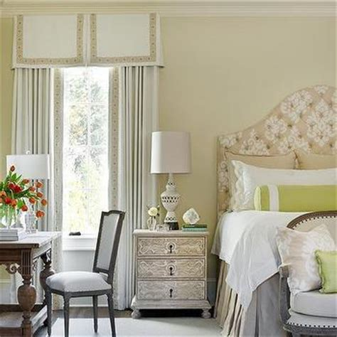 fleur de lis headboard valance and curtains behind bed transitional bedroom