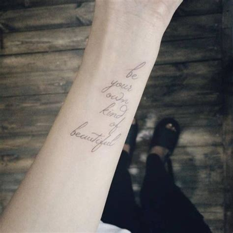 wrist tattoo saying be your own kind of beautiful