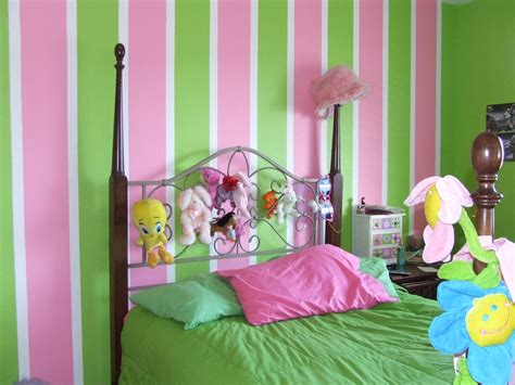 bedroom decor selection comes with green pink line wall painting and brown wooden sleigh bed