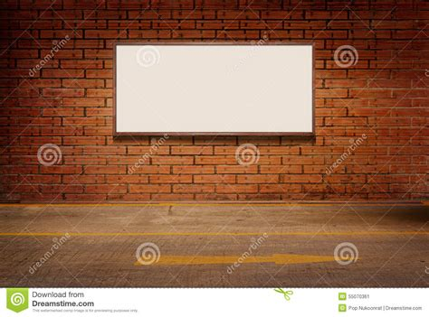 white wall with board and lights stock photo light box or white board on brick grunge wall and