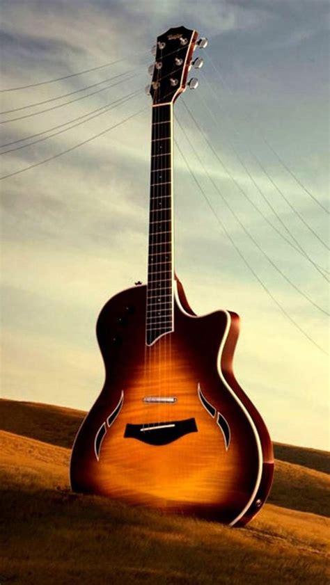 wallpaper iphone guitar guitar in sand iphone 5 wallpaper 640x1136
