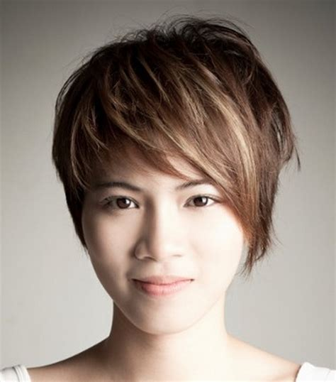 photo of hairstyle that is longer on one side long layered pixie haircut