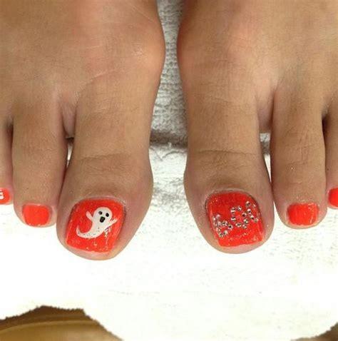 picture  orange toe nails  ghosts  boo letters
