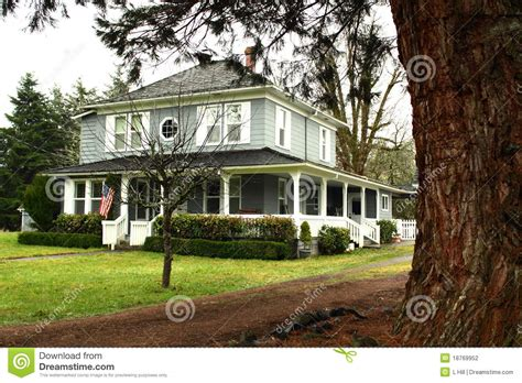 large country homes large country home with wide wrap around porch stock photo