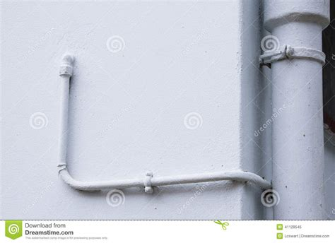 Metal Plumbing Pipes by Painted Metal Plumbing Pipes On Pale Blue Wall Stock Photo