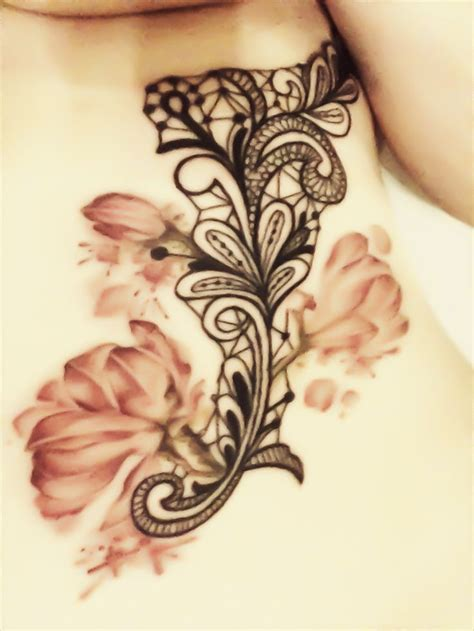 watercolor tattoos hamilton ribs lace with flower work done by aimee at