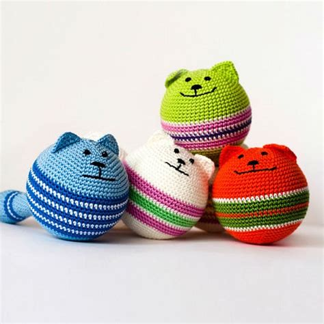 Handmade Knitted Toys - knitted cat in orange and green colors on a plastic