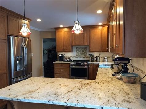 medium brown cabinets with granite countertops 13 colonial gold granite counters to install today