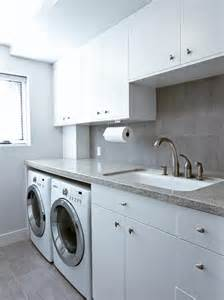 White modern laundry room with storage and sink this modern laundry