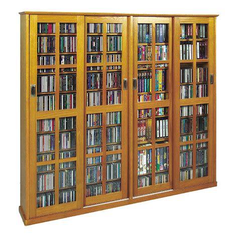 leslie dame multimedia storage cabinet leslie dame glass 4 door multimedia storage cabinet oak ms
