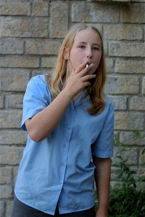 very young little girls smoking cigs do not make teens thinner