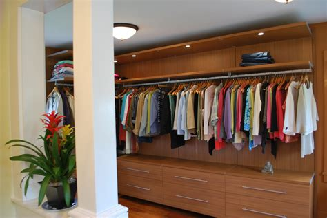 Closet Custom Design by Built In Space Saving Cabinetery For Clothes Organizers With Interior Brown Wooden Sliding Doors